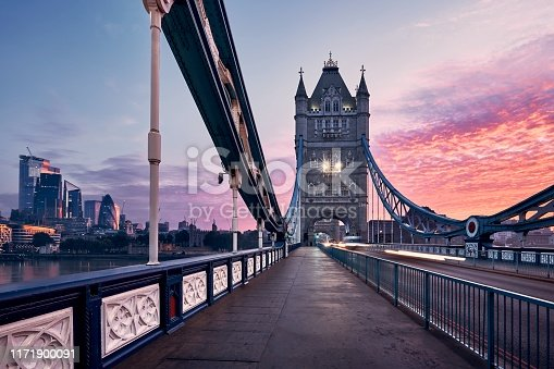 Skyline of London. Tower Bridge against cityscape with skyscrapes at colorful sunrise.