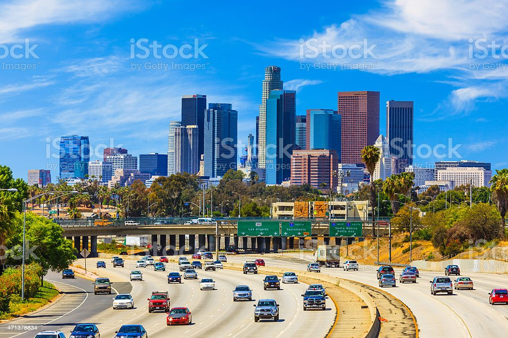 Skyline of Los Angeles with freeway traffic,CA Heavy traffic on freeway leading back to skyscrapers of Los Angele skyline. 2015 Stock Photo