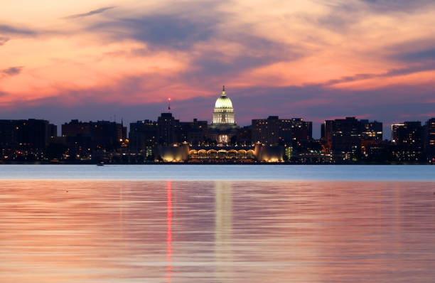 Skyline of Madison Wisconsin at dusk. Beautiful Madison night cityscape with downtown skyline, Monona terrace and capitol building against bright color after sunset sky and reflection in the Monona lake. madison wisconsin stock pictures, royalty-free photos & images