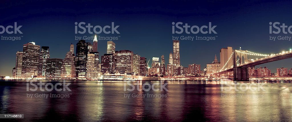 Skyline of Manhattan with Brooklyn bridge by night royalty-free stock photo