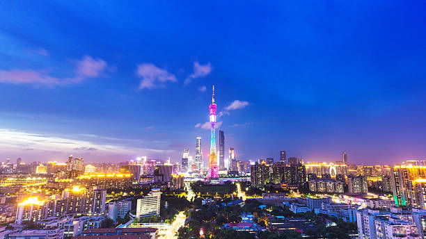 skyline of modern city with sunset in guangzhou - guangzhou stok fotoğraflar ve resimler