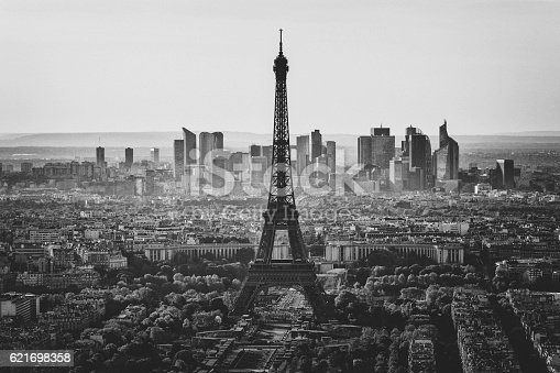 View in black and white over central Paris with the Eiffel tower in the center, and La Defense business district beyond.