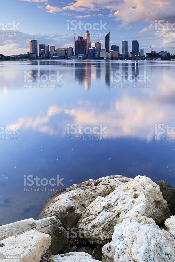 Skyline of Perth, Australia across the Swan River at sunset stock photo