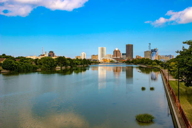 Skyline of Rochester, New York along Genesee River at sunset. stock photo