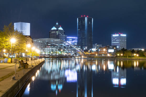 skyline of rochester new york at night - rochester ny skyline stock photos and pictures