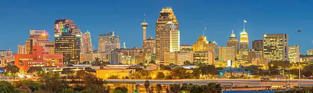 Skyline of San Antonio Texas USA Panoramic stock photo of the downtown skyline of San Antonio, Texas, USA, illuminated at twilight blue hour. san antonio texas stock pictures, royalty-free photos & images