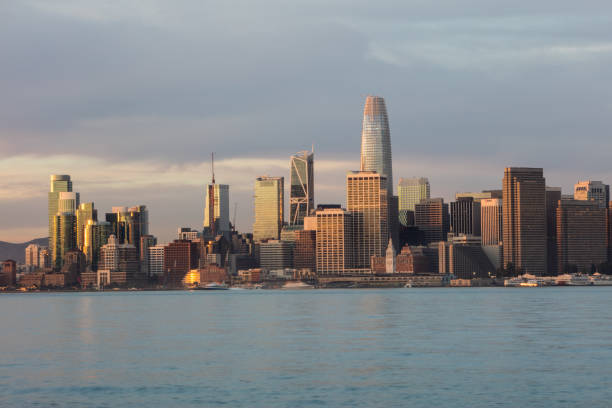 Skyline of San Francisco at Sunrise Sunrise greets the beautiful Northern California city of San Francisco. This scenic, modern metropolis is located on the edge of the Pacific Ocean and just west of the city of Oakland. san francisco bay stock pictures, royalty-free photos & images