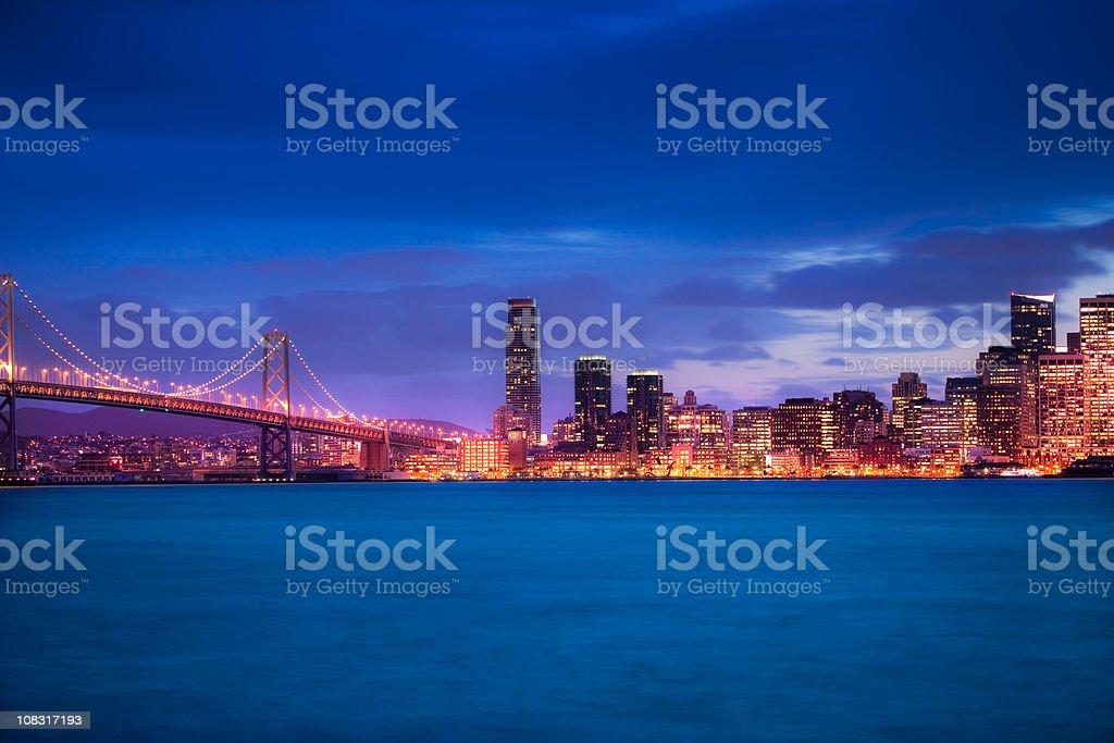 Skyline of San Francisco with Bay bridge at night royalty-free stock photo