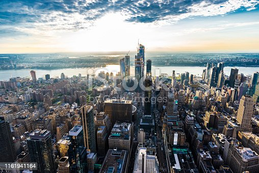 Elevated view of the skyline of modern skyscrapers of Hudson Yards and Union City along the Hudson river in Midtown Manhattan at sunset in New York City, USA