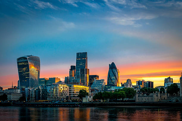 Skyline of The City in London, England at sunrise The City, one of the most important global financial center landmarks of the world, and the most important international business center in Europe, on the North bank of river Thames in London, England london england stock pictures, royalty-free photos & images