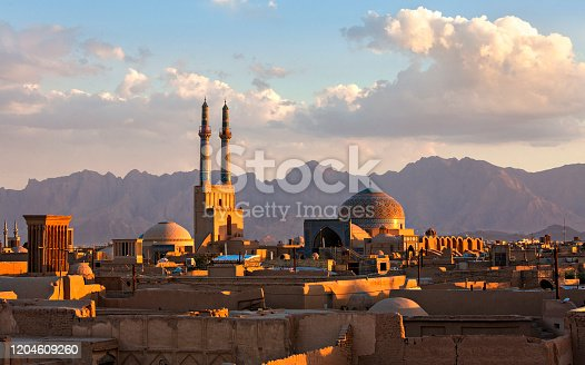 Sunset over the city of Yazd with the minarets and the dome of the Jameh Mosque, Iran