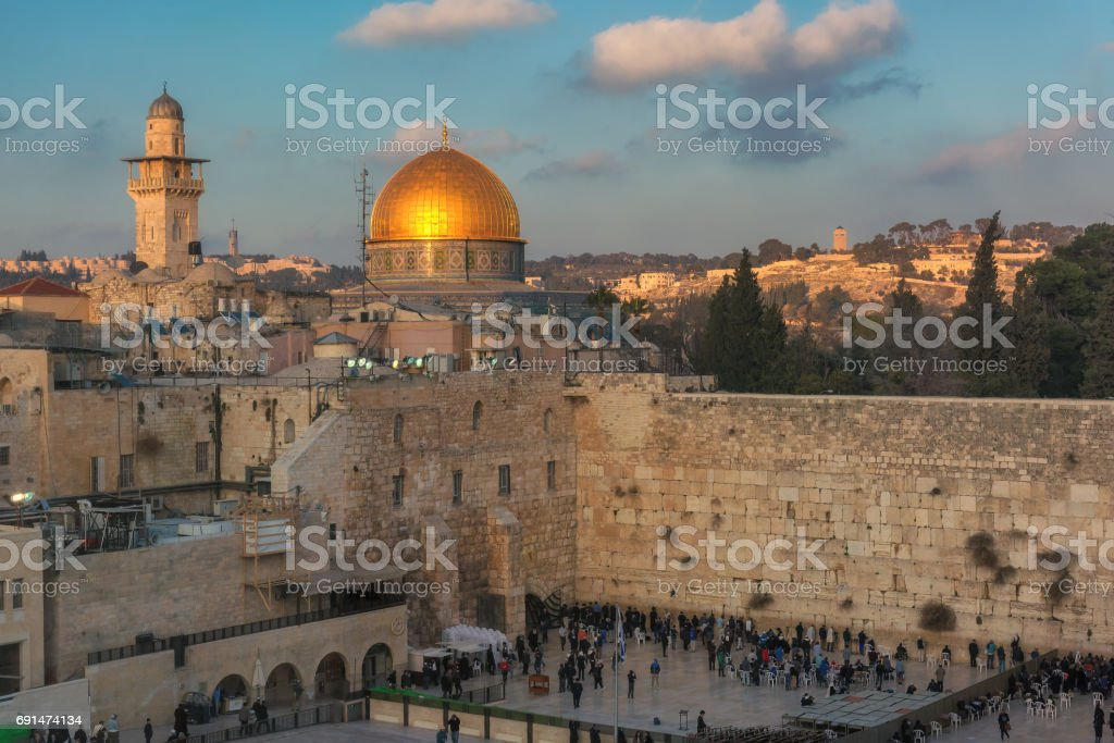 Skyline of the Jerusalem Old City at the Western Wall and Temple Mount at sunset/ stock photo