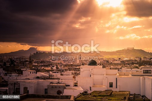 Skyline of Tunis. Traditional architecture in cityscape at dawn with dramatic sunlight. Tunisia, North africa.