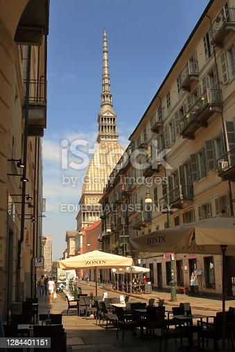 Turin, Italy - september 2020: skyline of Antonellian Mole from the dehor of a bar in central Po avenue.