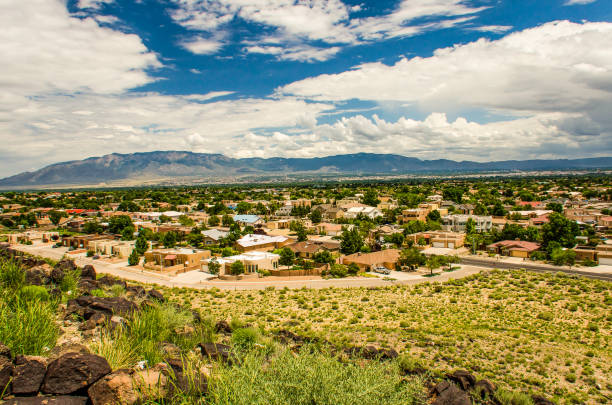 Skyline or cityscape of city with residential suburban houses near Petroglyph National Monument stock photo