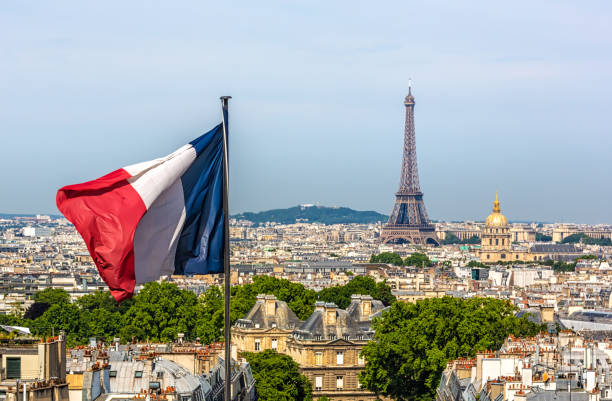 Skyline Paris with Eiffel Tower and French flag stock photo