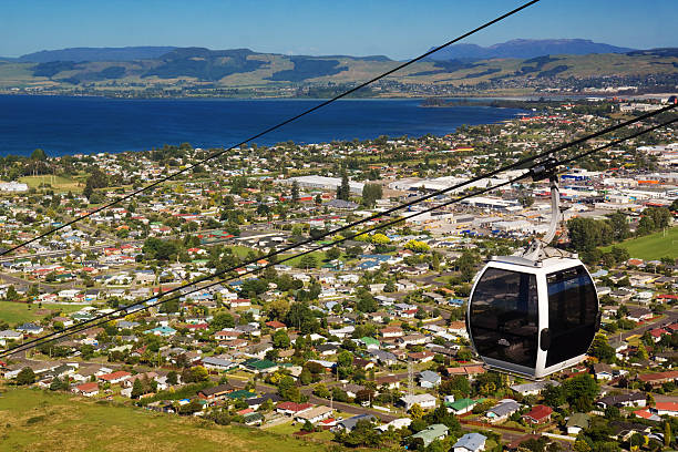 Skyline Rotorua A cable car heads above the town of Rotorua, New Zealand. rotorua stock pictures, royalty-free photos & images