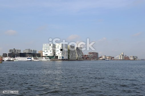 A view at the modern office buildings and appartements on the south bank of the river IJ in Amsterdam. This area on the West side of the Central Railway Station is locally called \