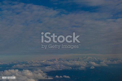 900763322 istock photo Skyline View above the Clouds from air plane 858151538