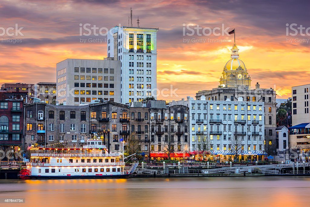 Skyline view of Savannah, Georgia with water in the front stock photo