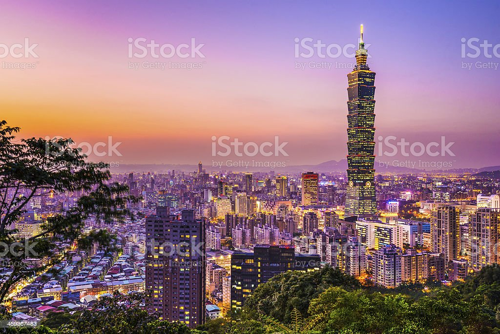 Skyline view of Taipei glowing in the sunset light Modern office buildings in Taipei, Taiwan at dusk. Architecture Stock Photo