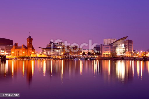 A tranquil scene of Cardiff Bay on a calm evening. In this city scape you can see the Pierhead building (1897) and National Assembly for Wales with the Bay in the foreground.