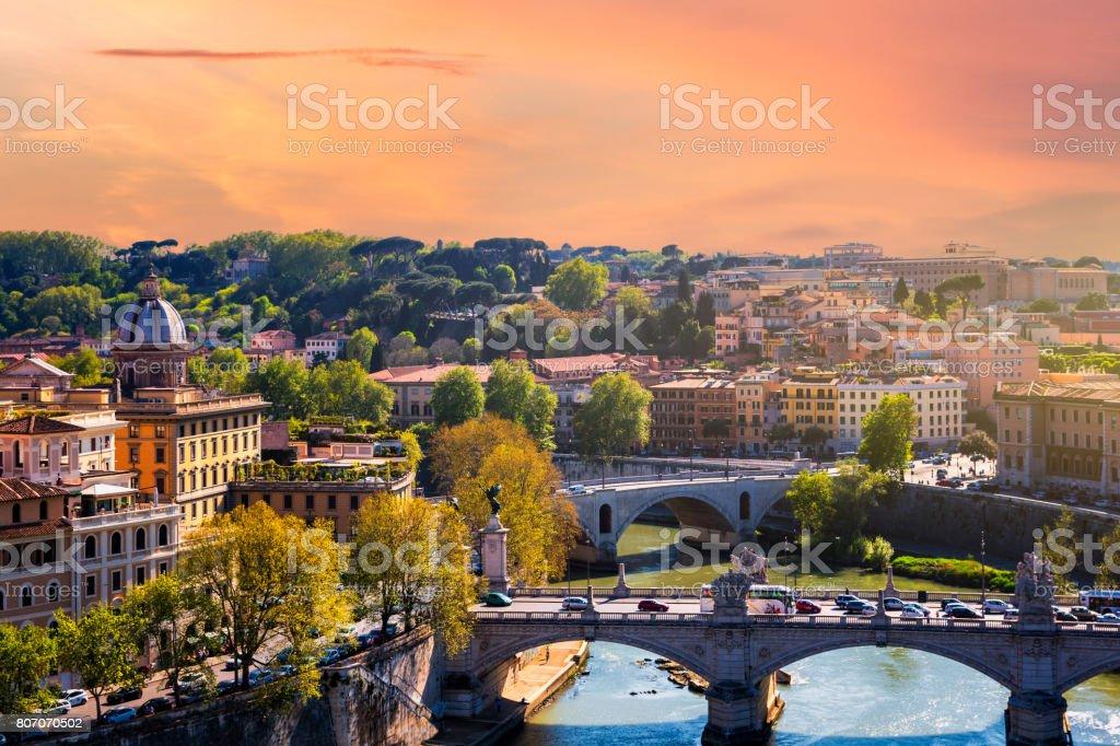 Skyline with bridge Ponte Vittorio Emanuele II and classic architecture in Rome, Vatican City scenery over Tiber river. stock photo