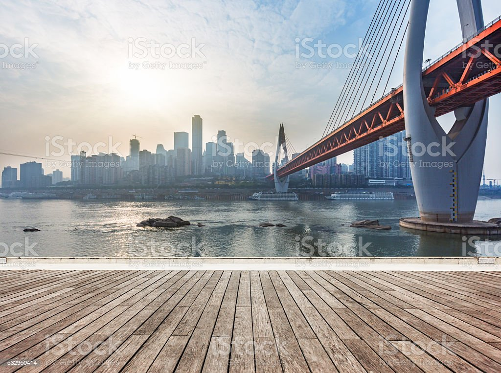 skyline,river and bridge during sunset stock photo