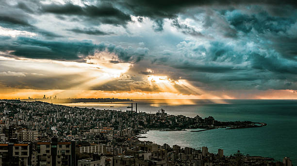SkyNews Dramatic sky and sunset over Beirut City and it's Mediterranean sea. Shot taken from a vintage point above Jounieh bay seen in the foreground. beirut stock pictures, royalty-free photos & images