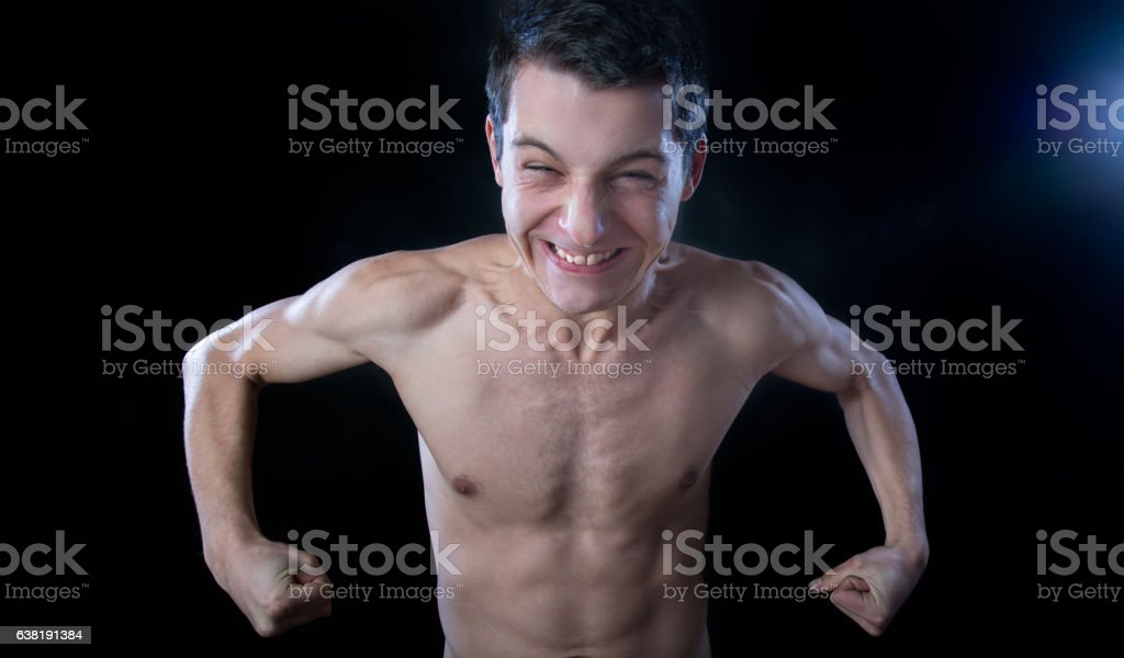 skynny man makink muscle stock photo