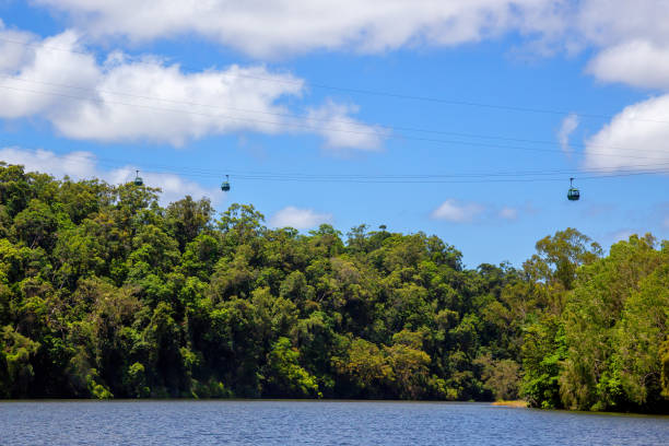 Skyrail Rainforest Cableway gondolas above the beautiful Barron River near Kuranda in Tropical North Queensland, Australia stock photo