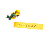 Antrim, Northern Ireland - September 20, 2013.  A Lego skydiver diving past the wise words of 'The sky's the limit'
