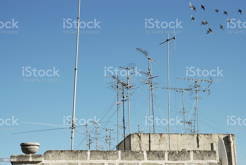Skyscape with antennas and birds. royalty-free stock photo
