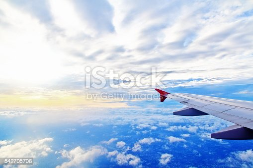 istock Skyscape with wing of plane 542705706