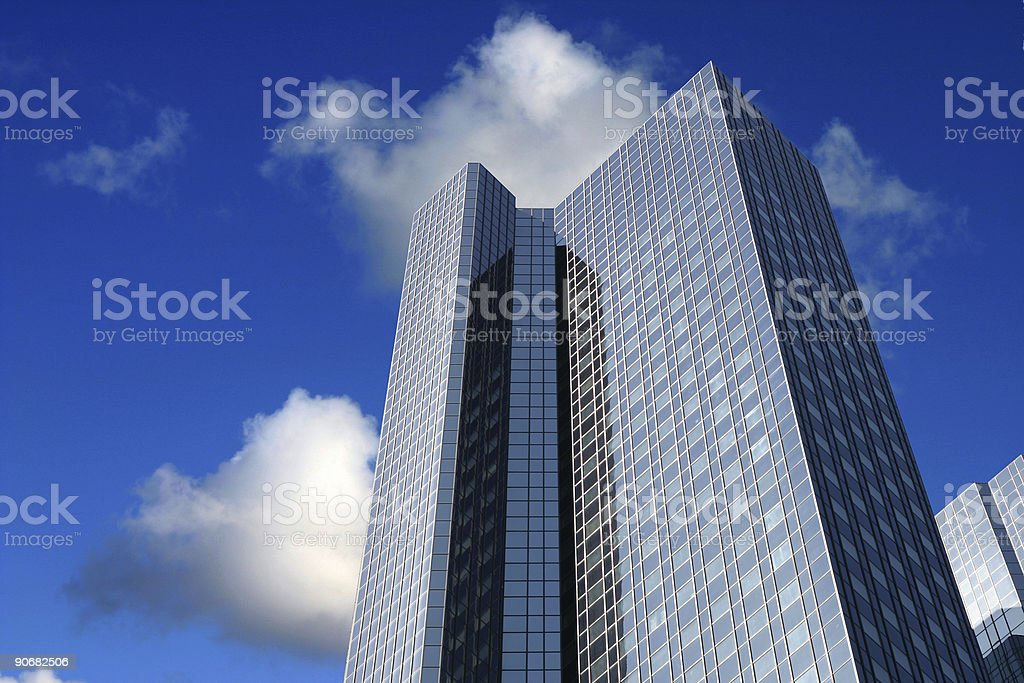 Skyscraper and blue cloudy sky royalty-free stock photo