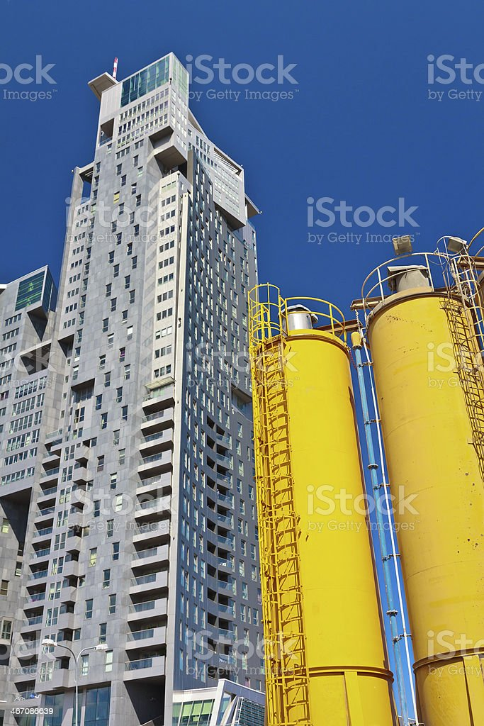 Skyscraper and cement silos, Gdansk, Poland royalty-free stock photo