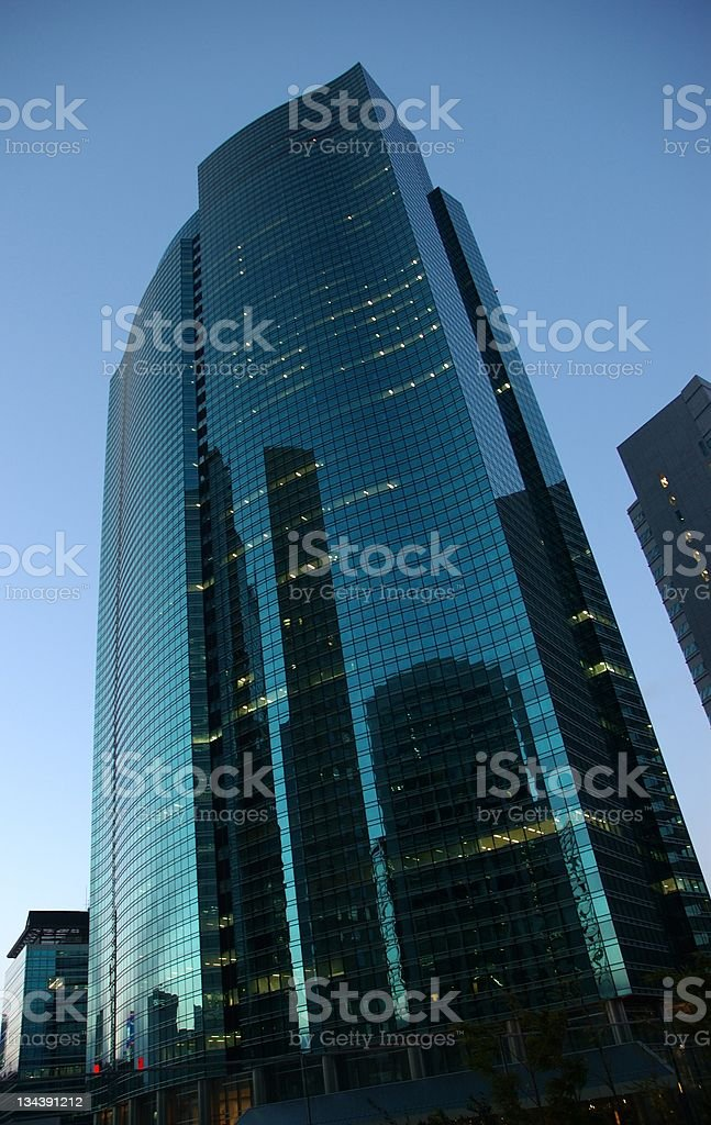 Skyscraper and reflections stock photo