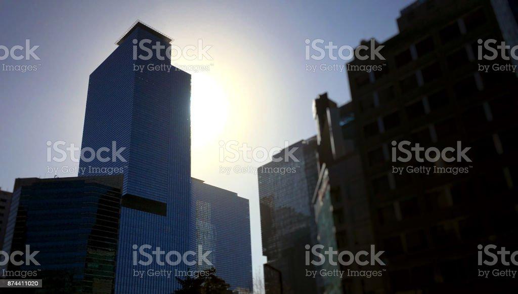 Skyscraper and sun stock photo