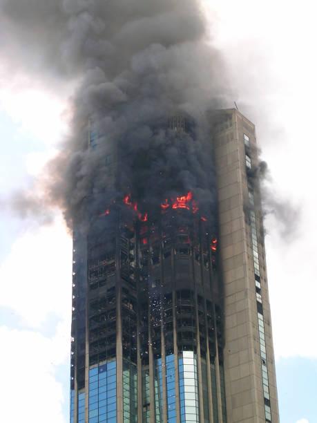 Skyscraper building on fire stock photo