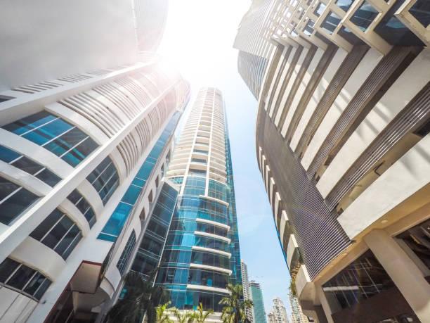skyscraper buildings, looking up in downtown city - consumismo foto e immagini stock