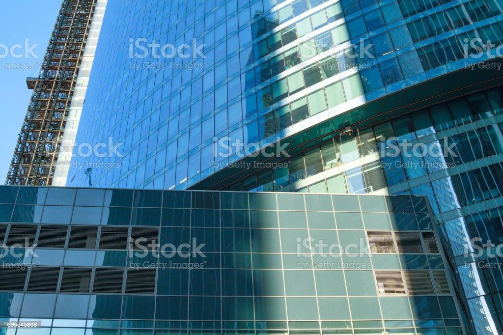 Skyscraper construction. To height of  skyscraper hoist down service elevator leftwards. stock photo