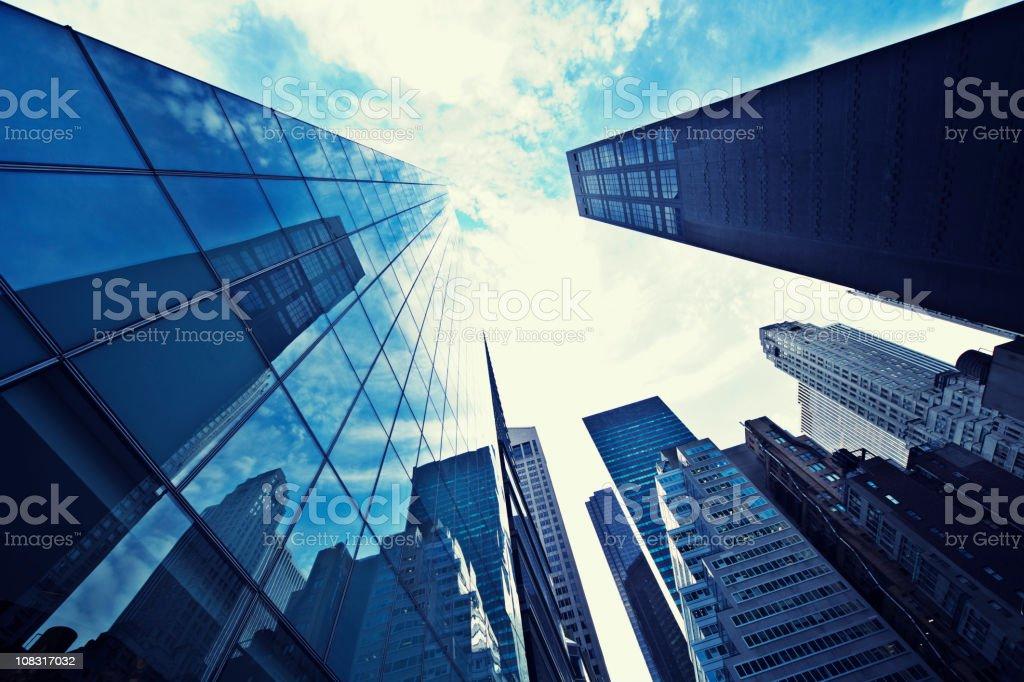 skyscraper manhattan reflecting in facade royalty-free stock photo