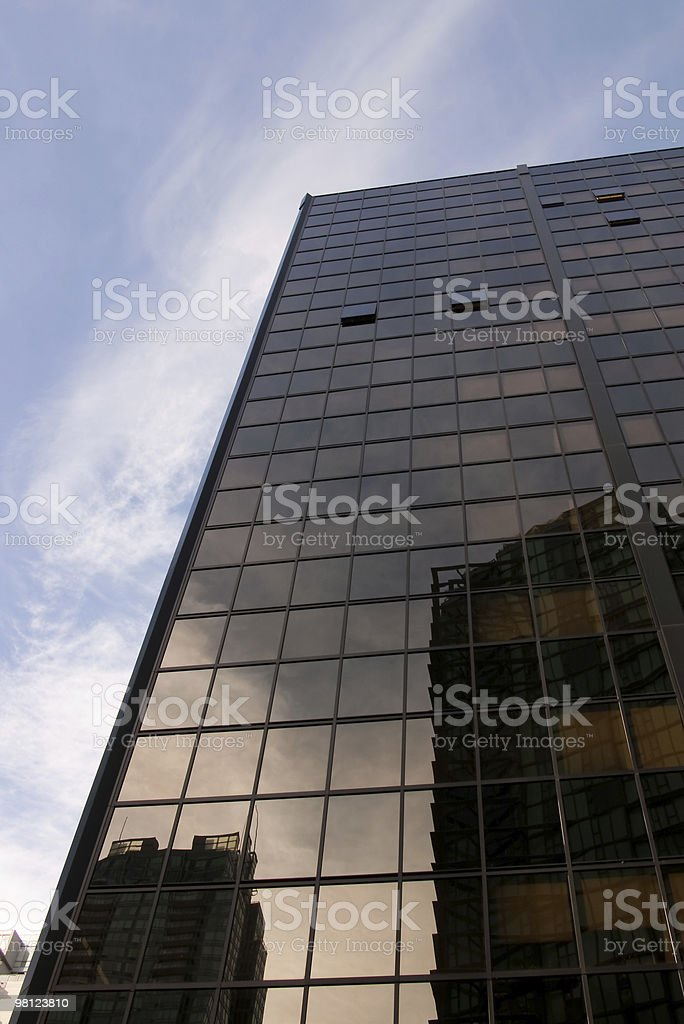 Skyscraper Office Building with Reflections on Sunny Day royalty-free stock photo