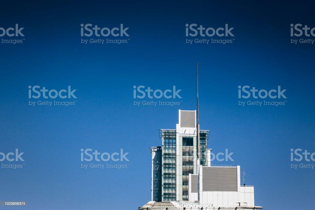 Skyscraper on blue background stock photo