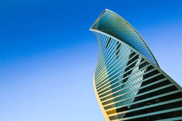 Skyscraper on blue sky. Skyscraper exterior design. Modern office building with glass facade in blue sky. Neo-futuristic architectural style. Urban view, looking up, skyline. Moscow city. Business Center. skyscraper stock pictures, royalty-free photos & images