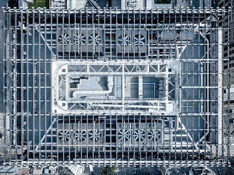 Aerial picture of skyscraper rooftop with structure and air conditioning and ventilation units