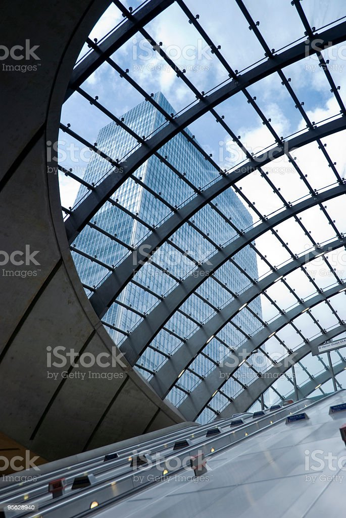 Skyscraper through the glass roof of a tube station stock photo