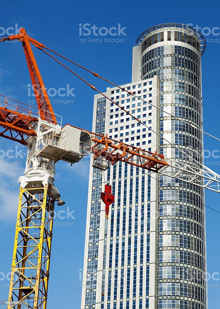 Skyscraper top and Crane Excerpt stock photo