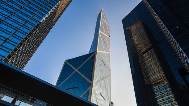Skyscraper towers in Hong Kong Hong Kong - December 9, 2016: Bank of China tower is a modern office building in central business area of Hong Kong. bank of china stock pictures, royalty-free photos & images