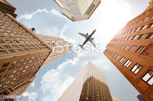 182061540 istock photo Skyscraper with a airplane 1135327437